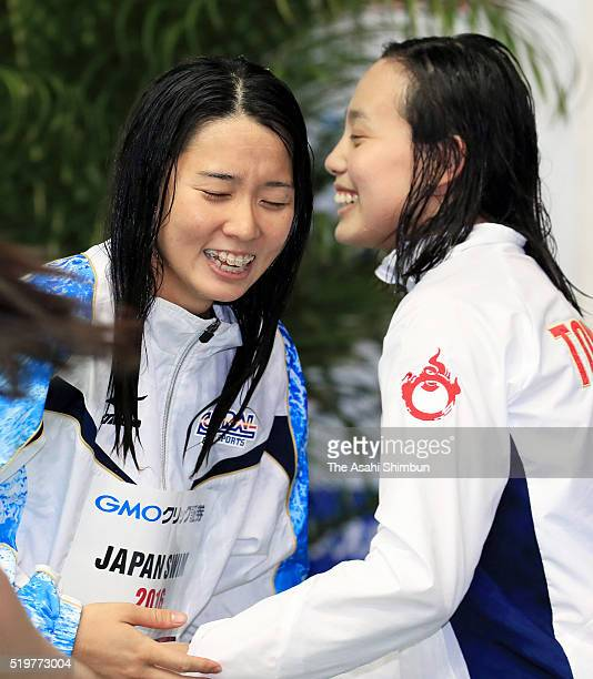 Second place Runa Imai and first place Miho Teramura celebrate qualifying for the Rio de Janeiro Olympic Games in the Women's 200m Individual Medley...