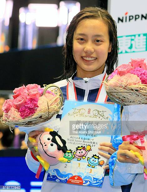 Second place Runa Imai celebrates on the podium after qualifying for the Rio de Janeiro Olympic Games in the Women's 200m Individual Medley during...