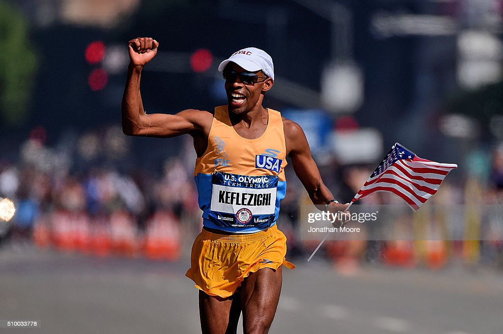 Second place runner <a gi-track='captionPersonalityLinkClicked' href=/galleries/search?phrase=Meb+Keflezighi&family=editorial&specificpeople=225084 ng-click='$event.stopPropagation()'>Meb Keflezighi</a> celebrates as he approaches the finish line during the U.S Olympic Marathon Team Trials on February 13, 2016 in Los Angeles, California.
