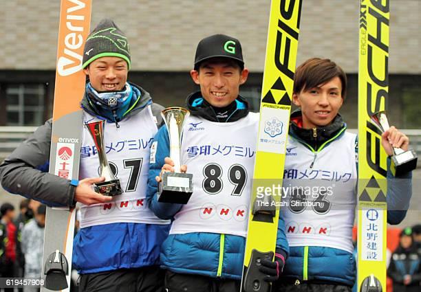 Second place Ryoyu Kobayashi winner Daiki Ito and third place Kento Sakuyama pose on the podium after the men's competition of the Ski Jumping NHK...