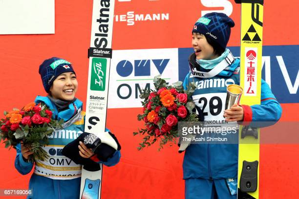 Second place Sara Takanashi and winner Yuki Ito celebrate on the podium at the medal ceremony for the Women's event during day two of the FIS Ski...