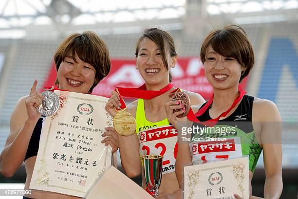 Second place Sayaka Fujisawa winner Chisato Fukushima and third place Kana Ichikawa pose for photographs during the award ceremony for the the...