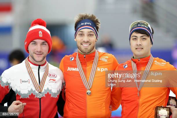 Second place Vincent De Haitre of Canada first place Kjeld Nuis of Netherlands and Kai Verbij of Netherlands celebrate during a medal ceremony in the...