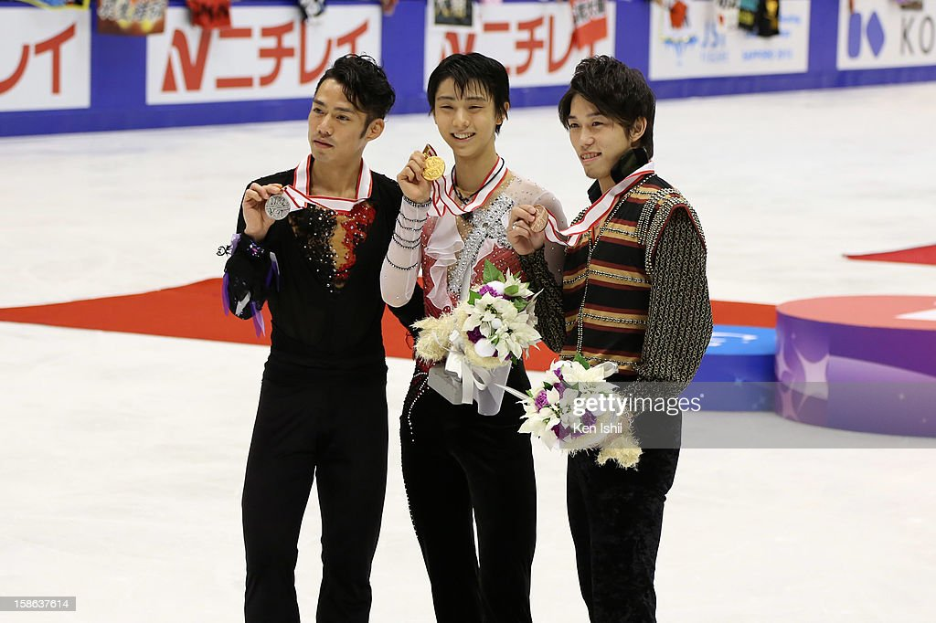 Second place winner Daisuke Takahashi, first place winner Yuzuru Hanyu, and third place winner Takahito Mura pose for photographs during day two of the 81st Japan Figure Skating Championships at Makomanai Sekisui Heim Ice Arena on December 22, 2012 in Sapporo, Japan.