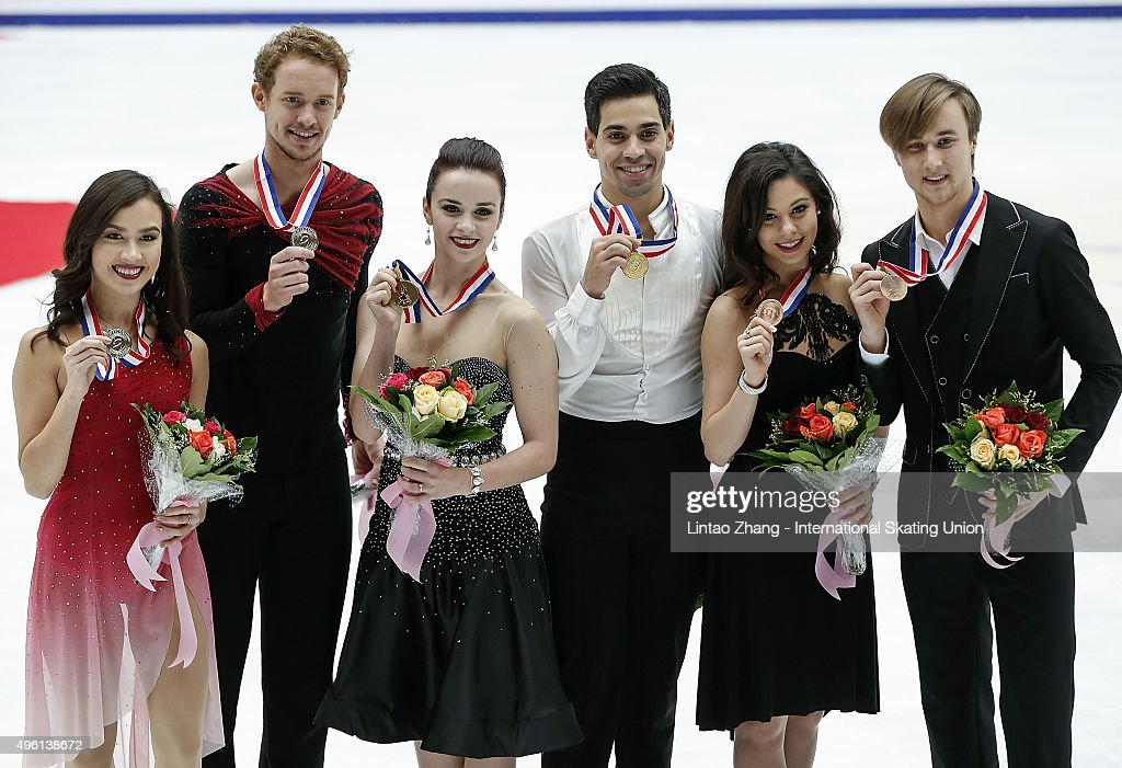 Second place winner <a gi-track='captionPersonalityLinkClicked' href=/galleries/search?phrase=Madison+Chock&family=editorial&specificpeople=6471803 ng-click='$event.stopPropagation()'>Madison Chock</a> and <a gi-track='captionPersonalityLinkClicked' href=/galleries/search?phrase=Evan+Bates&family=editorial&specificpeople=4839407 ng-click='$event.stopPropagation()'>Evan Bates</a> of United States, First place winner <a gi-track='captionPersonalityLinkClicked' href=/galleries/search?phrase=Anna+Cappellini&family=editorial&specificpeople=4036081 ng-click='$event.stopPropagation()'>Anna Cappellini</a> and <a gi-track='captionPersonalityLinkClicked' href=/galleries/search?phrase=Luca+Lanotte&family=editorial&specificpeople=4031110 ng-click='$event.stopPropagation()'>Luca Lanotte</a> of Italia and Third place winner <a gi-track='captionPersonalityLinkClicked' href=/galleries/search?phrase=Elena+Ilinykh&family=editorial&specificpeople=7281567 ng-click='$event.stopPropagation()'>Elena Ilinykh</a> and Ruslan Zhiganshin of Russia pose on the podium after the medals ceremony of the Ice Dancing short Dance Program on day two of Audi Cup of China ISU Grand Prix of Figure Skating 2015 at Beijing Capital Gymnasium on November 7, 2015 in Beijing, China.