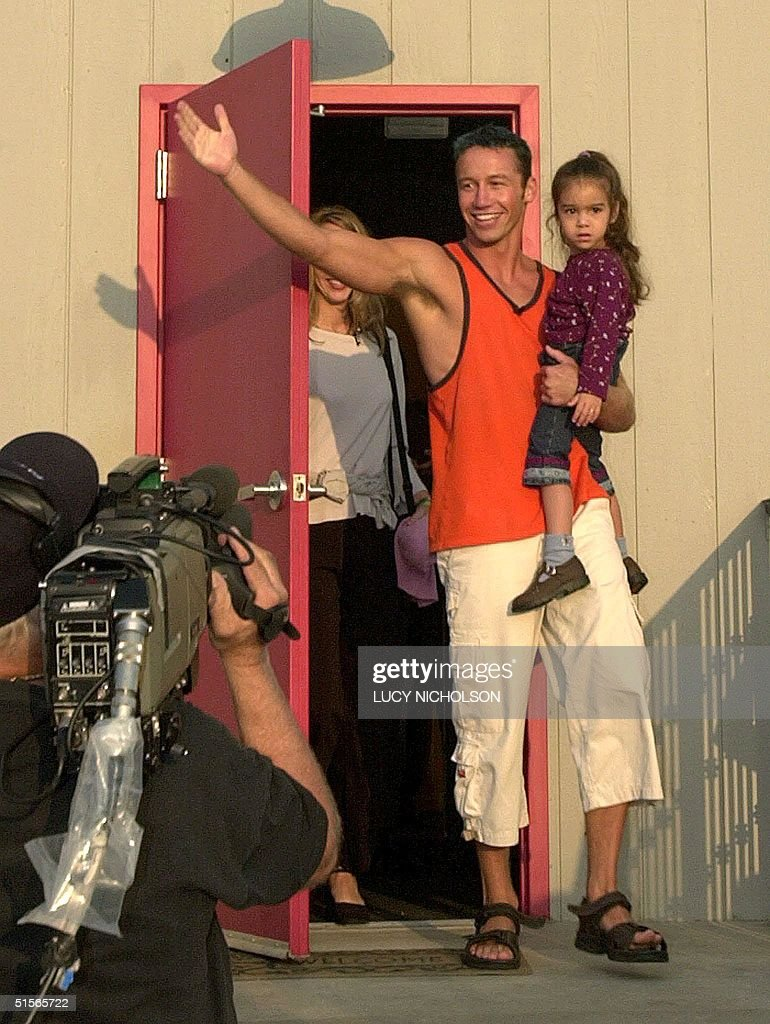 US second place winner of 'Big Brother' reality television show Joshua Souza exits the 'Big Brother' house holding his niece Kiara Dandridge on a CBS...