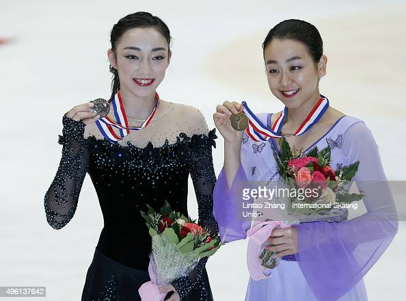 Second place winner Rika Hongo and First place winner Mao Asada of Japan pose on the podium after the medals ceremony of the Ladies Short Program on...