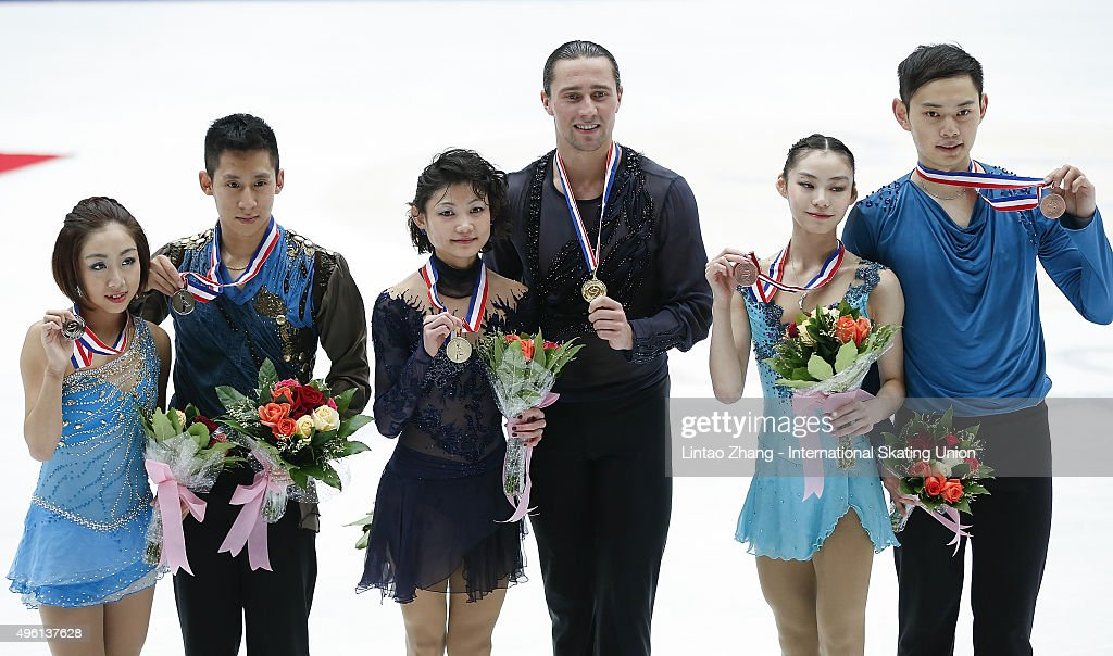 Second place winner Wending Sui and Cong Han of China, First place winner Yuko Kavaguti and <a gi-track='captionPersonalityLinkClicked' href=/galleries/search?phrase=Alexander+Smirnov&family=editorial&specificpeople=4045603 ng-click='$event.stopPropagation()'>Alexander Smirnov</a> of Russia and Third place winner Xiaoyu Yu and Yang Jin of China pose on the podium after the medals ceremony of the Pairs Short Program on day two of Audi Cup of China ISU Grand Prix of Figure Skating 2015 at Beijing Capital Gymnasium on November 7, 2015 in Beijing, China.