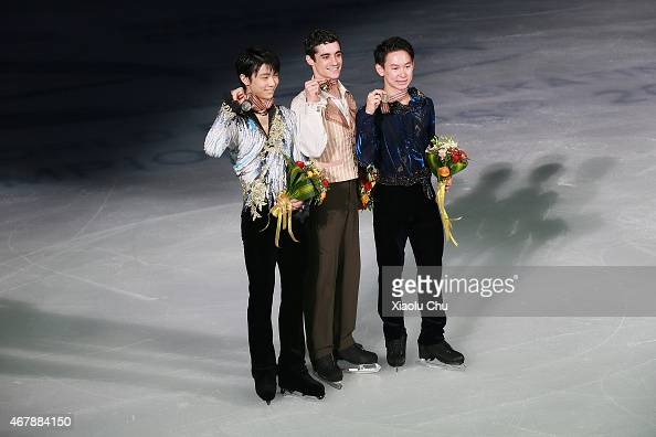 Second place winner Yuzuru Hanyu of Japan first place winner Javier Fernandez of Spain third place winner Denis Ten of Kazakhstan pose for photo...