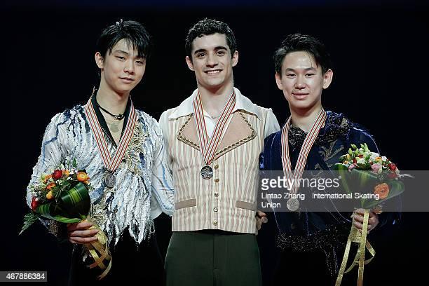 Second place winner Yuzuru Hanyu of Japan First place winner Javier Fernandez of Spain and Third place winner Denis Ten of Kazakhstan pose on the...