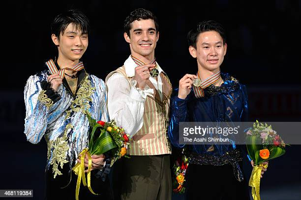 Second place winner Yuzuru Hanyu of Japan first place winner Javier Fernandez of Spain and third place winner Denis Ten of Kazakhstan pose for...