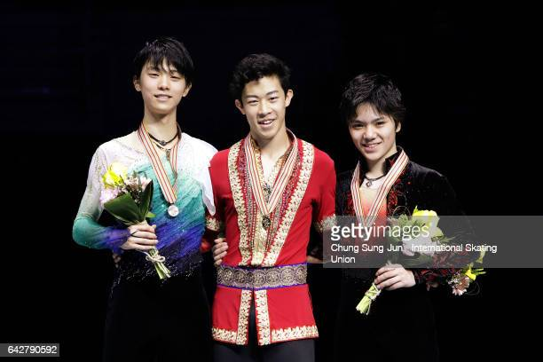 Second place winner Yuzuru Hanyu of Japan first place winner Nathan Chen of United States and third place winner Shoma Uno of Japan pose on the...