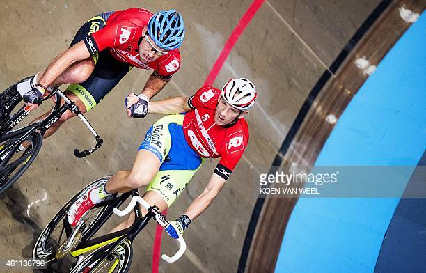 Second place winners Danish cycling couple Michael Morkov and Alex Rasmussen compete on the final day of the Zesdaagse van Rotterdam cycling event in...
