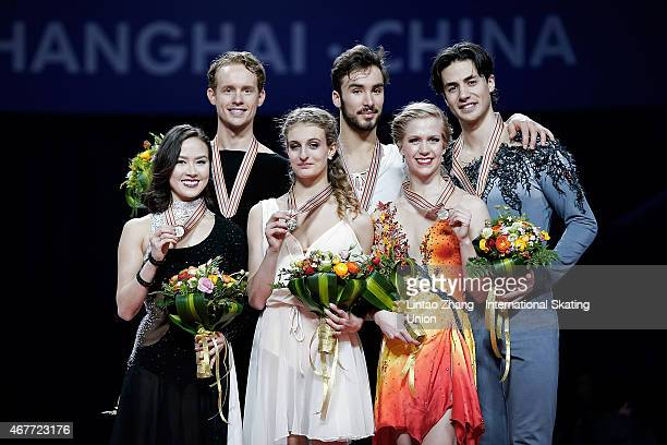 Second place winners Madison Chock and Evan Bates of United States First place winners Gabriella Papadakis and Guillaume Cizeron of France and Third...