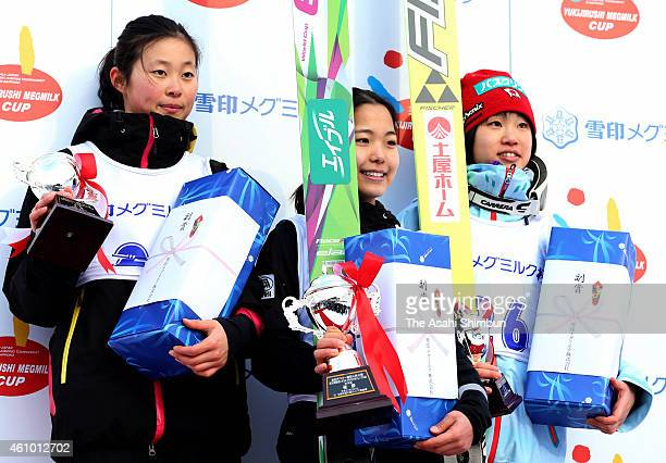 Second place Yuka Seto winner Sara Takanashi and third place Yuki Ito pose on the podium at the medal ceremony for the Women's ski jumping of the...