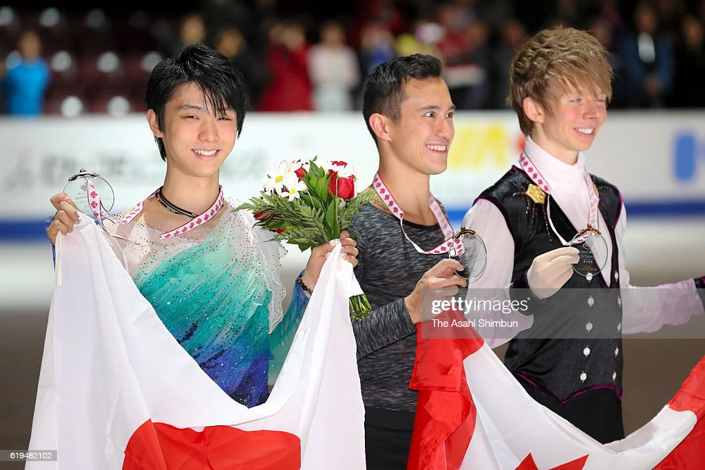 Команда Канады в общем и целом - Страница 4 Second-place-yuzuru-hanyu-of-japan-first-place-patrick-chan-of-canada-picture-id619482102