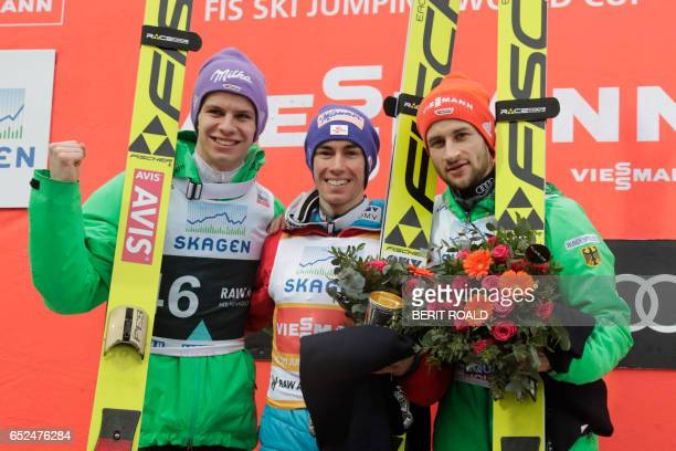 Second placed Andreas Wellinger of Germany winner Stefan Kraft of Austria and third placed Markus Eisenbichler of Germany pose on the podium after...