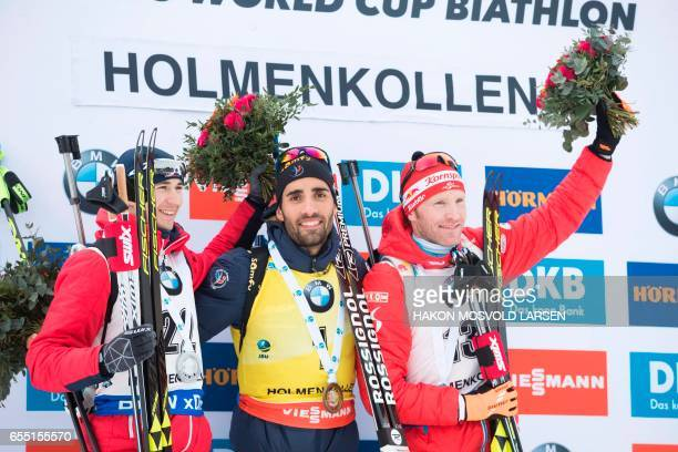 Second placed Andrejs Rastorgujevs from Latvia winner Martin Fourcade from France and Simon Eder from Austria celebrate on the podium after IBU...