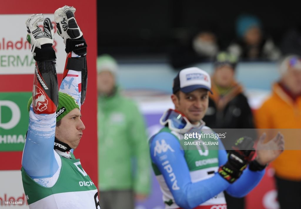 Second placed Austria's Marcel Hirscher and third placed Italy's Manfred Moelgg pose on the podium after the men's Giant slalom at the 2013 Ski World Championships in Schladming, Austria on February 15, 2013. KUBANI
