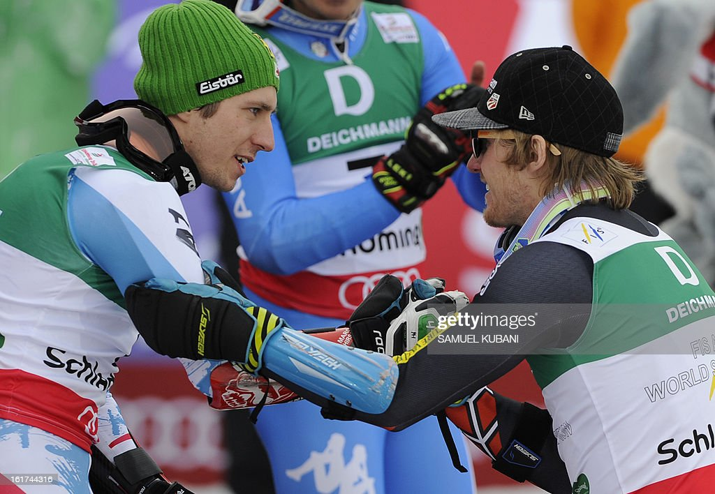 Second placed Austria's Marcel Hirscher (L) greets winner US Ted Ligety on the podium after the men's Giant slalom at the 2013 Ski World Championships in Schladming, Austria on February 15, 2013. KUBANI