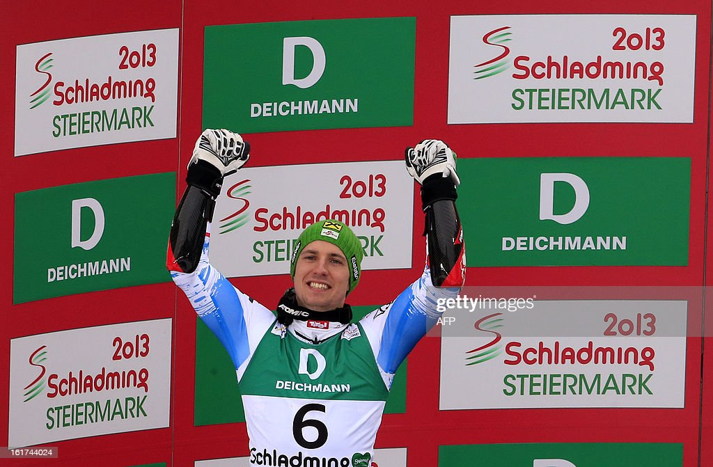 Second placed Austria's Marcel Hirscher poses on the podium after the men's Giant slalom at the 2013 Ski World Championships in Schladming, Austria on February 15, 2013. KLEIN