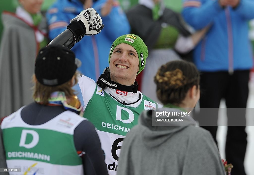 Second placed Austria's Marcel Hirscher raises his fist on the way to the podium after the men's Giant slalom at the 2013 Ski World Championships in Schladming, Austria on February 15, 2013. KUBANI