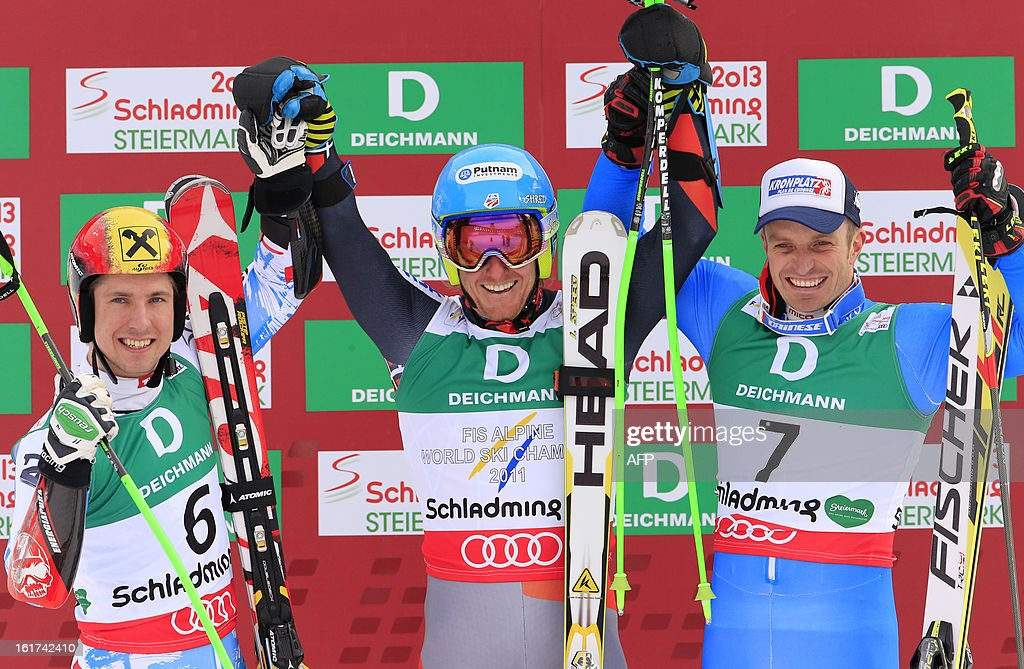 Second placed Austria's Marcel Hirscher, winner US Ted Ligety and third placed Italy's Manfred Moelgg pose after the men's Giant slalom at the 2013 Ski World Championships in Schladming, Austria on February 15, 2013. KLEIN