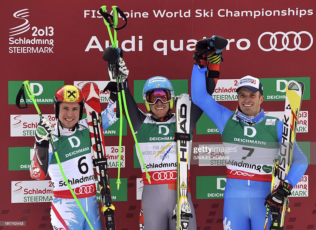 Second placed Austria's Marcel Hirscher, winner US Ted Ligety and third placed Italy's Manfred Moelgg pose after the men's Giant slalom at the 2013 Ski World Championships in Schladming, Austria on February 15, 2013. KUBANI