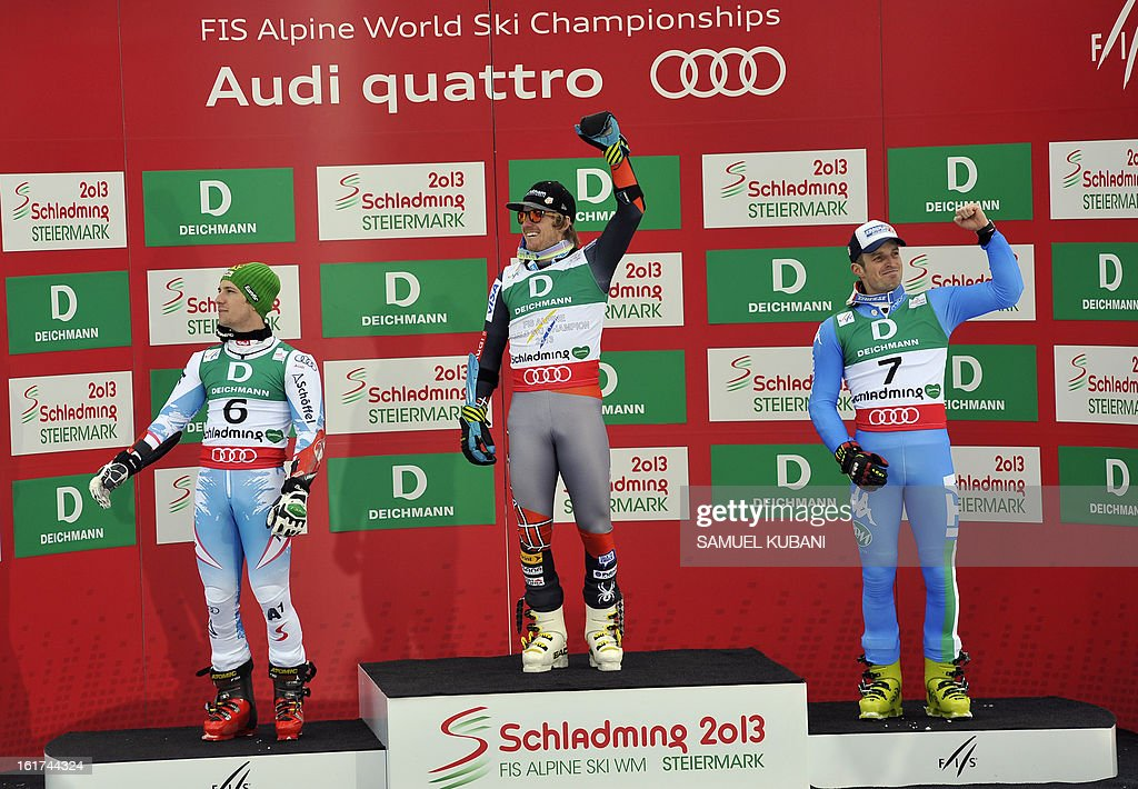 Second placed Austria's Marcel Hirscher, winner US Ted Ligety and third placed Italy's Manfred Moelgg pose on the podium after the men's Giant slalom at the 2013 Ski World Championships in Schladming, Austria on February 15, 2013. KUBANI