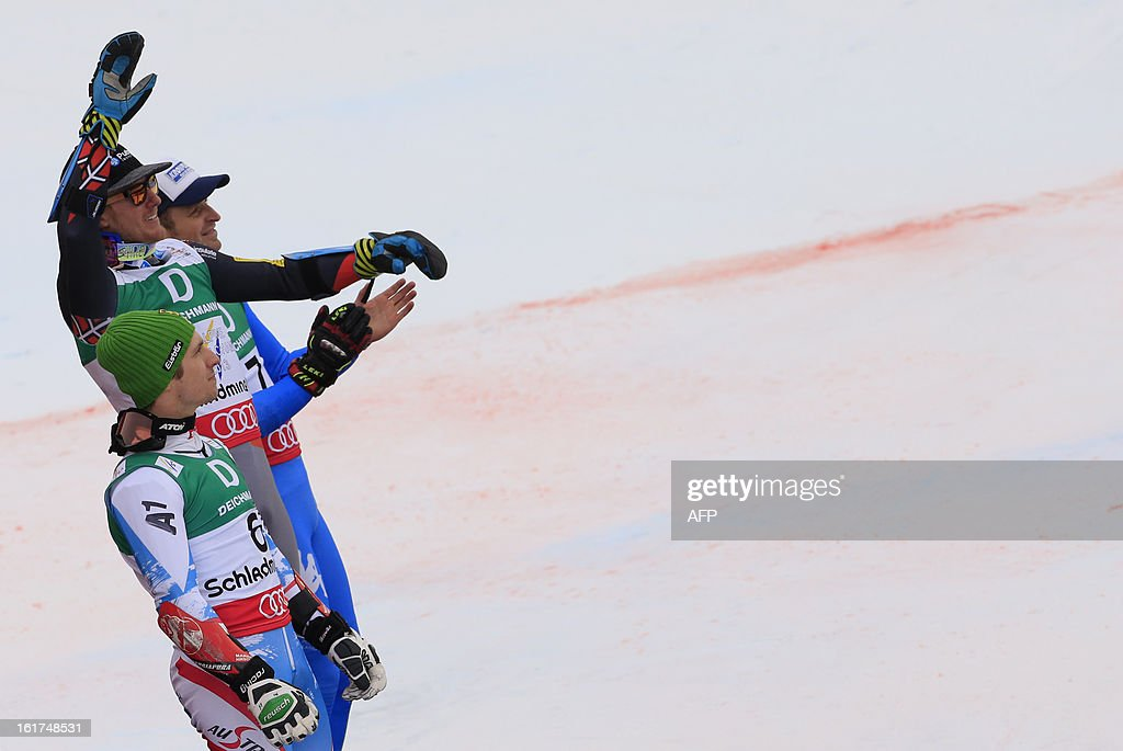 Second placed Austria's Marcel Hirscher, winner US Ted Ligety and third placed Italy's Manfred Moelgg pose on the podium after the men's Giant slalom at the 2013 Ski World Championships in Schladming, Austria on February 15, 2013. AFP PHOTO / ALEXANDER KLEIN