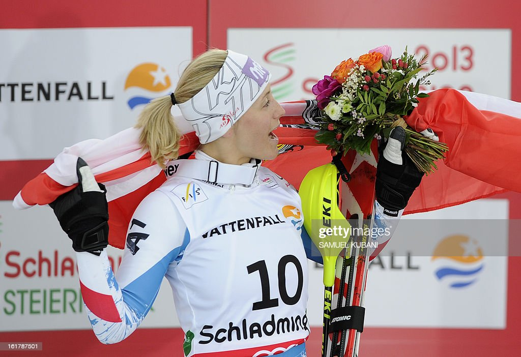 Second placed Austria's Michaela Kirchgasser celebrates on the podium after the women's slalom at the 2013 Ski World Championships in Schladming, Austria on February 16, 2013.