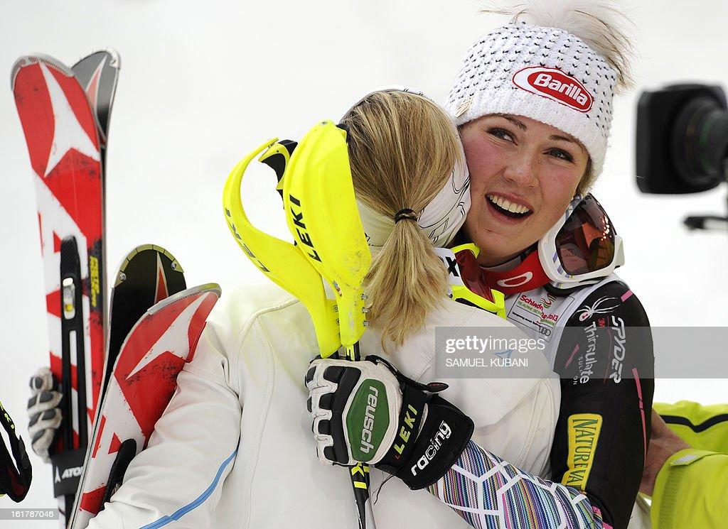 Second placed Austria's Michaela Kirchgasser (L) hugs winner US Mikaela Shiffrin after the women's slalom at the 2013 Ski World Championships in Schladming, Austria on February 16, 2013.