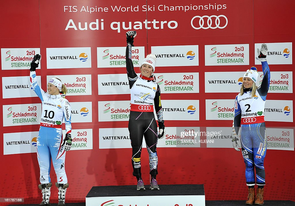 Second placed Austria's Michaela Kirchgasser, winner US Mikaela Shiffrin and third placed Sweden's Frida Hansdotter pose on the podium after the women's slalom at the 2013 Ski World Championships in Schladming, Austria on February 16, 2013.