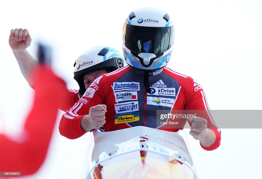 Second placed Beat Hefti and Thomas Lamparter of Switzerland celebrates after the Two Men Bobsleigh final heat of the IBSF Bob & Skeleton World Championship at Olympia Bob Run on January 27, 2013 in St Moritz, Switzerland.