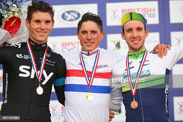 Second placed Ben Swift of Team SKY winner Peter Kennaugh of Team SKY and third placed Simon Yates of OricaGreenEdge celebrate on the podium after...