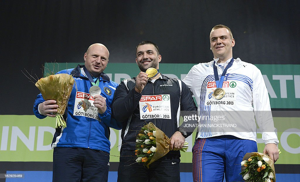 Second placed Bosnia's Hamza Alic, winner Serbia's Asmir Kolasinac and third placed Czech Republic's Ladislav Prasil celebrate with their medal on the podium after the final of the men's Shot Put event at the European Indoor athletics Championships in Gothenburg, Sweden, on March 1, 2013.