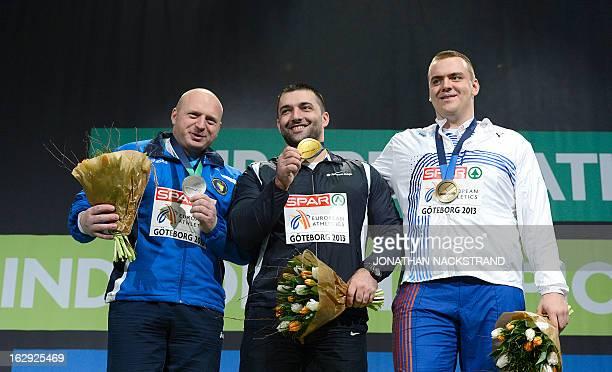 Second placed Bosnia's Hamza Alic winner Serbia's Asmir Kolasinac and third placed Czech Republic's Ladislav Prasil celebrate with their medal on the...