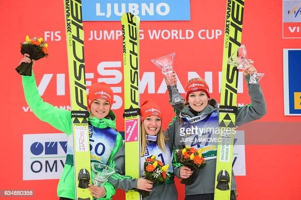 Second placed Carina Vogt of Germany winner Katharina Althaus of Germany and third placed Svenja Wuerth of Germany celebrate on podium after the...