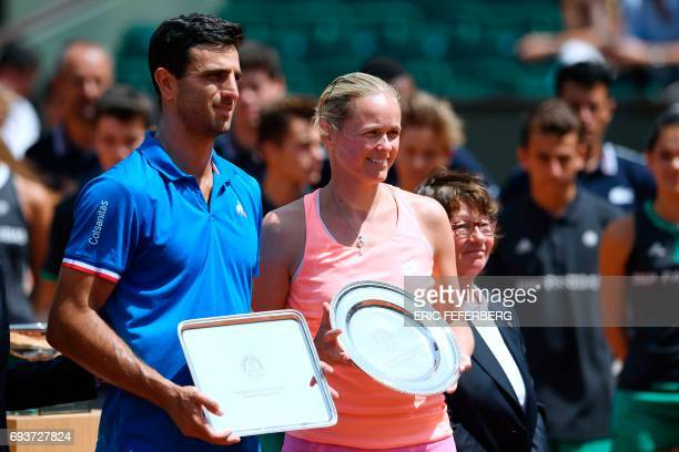 Second placed Colombia's Robert Farah and Germany's AnnaLena Groenefeld pose with their trophy after the mixed doubles tennis final at the Roland...