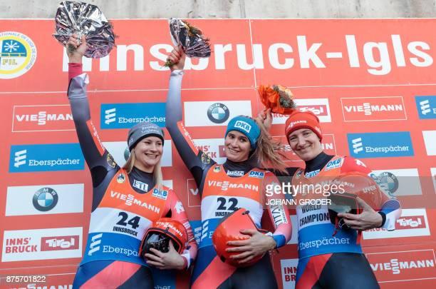 Second placed Dajana Eitberger of Germany winner Natalie Geisenberger of Germany and third placed Tatjana Huefner of Germany celebrate on the podium...