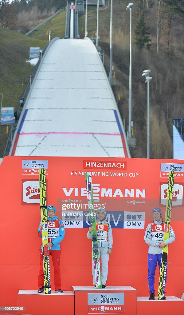 Second placed Daniela Iraschko-Stolz of Austria, first placed Sara Takanashi of Japan and third placed Maren Lundby of Norway pose on the podium after the women's ski jumping world cup in Hinzenbach, Upper Austria on February 6, 2016. / AFP / APA / BARBARA GINDL / Austria OUT