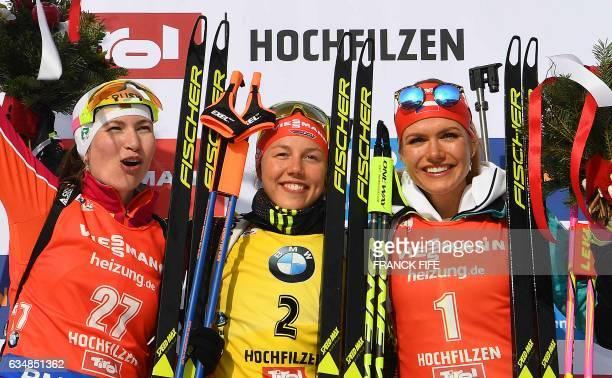 Second placed Darya Domracheva of Belarus winner Laura Dahlmeier of Germany and third placed Gabriela Koukalova of Czech Republic celebrate on the...