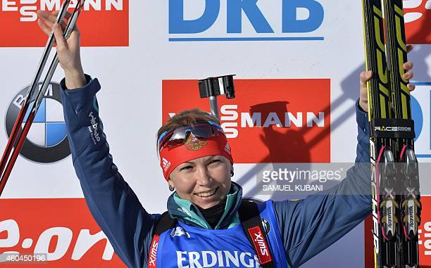 Second placed Ekaterina Glazyrina of Russia celebrates on the podium of the the women 10 km pursuit at the IBU World cup in biathlon in Hochfilzen on...