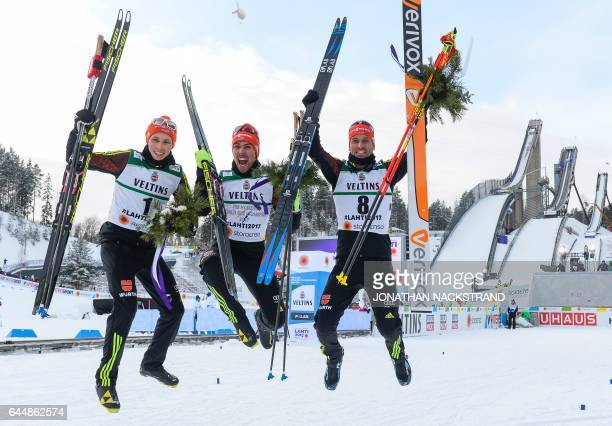 TOPSHOT Second placed Eric Frenzel winner Johannes Rydzek and third placed Bjoern Kircheisen of Germany react after crossing the finish line during...