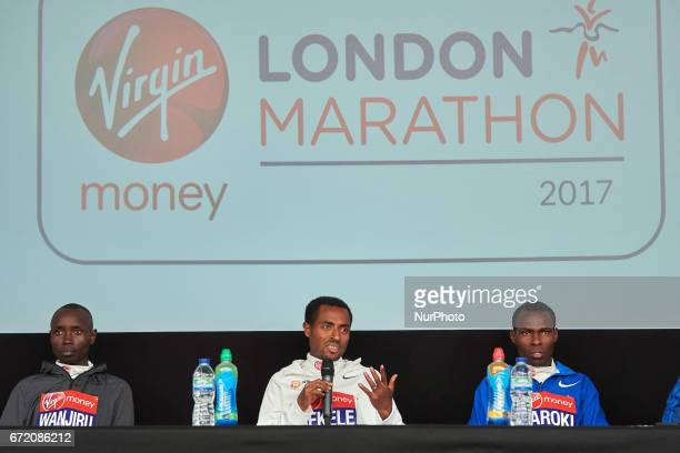 Second placed Ethiopia's Kenenisa Bekele winner Kenya's Daniel Wanjiru and third placed Kenya's Bedan Karoki during a press conference after the...