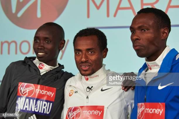 Second placed Ethiopia's Kenenisa Bekele winner Kenya's Daniel Wanjiru and third placed Kenya's Bedan Karoki pose on the podium during a press...