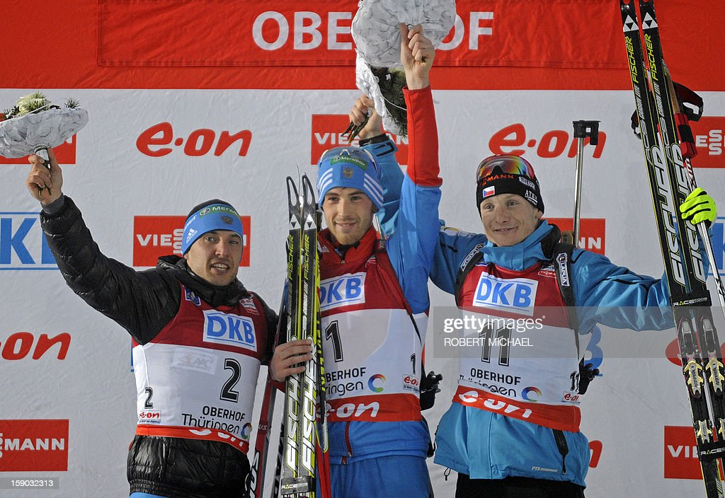 Second placed Evgeniy Garanichev, winner Dmitry Malyshko of Russia and Ondrej Moravec of Czech Republic celebrate on the podium after the men's 12,5 km pursuit event of the IBU biathlon World Cup in the eastern German town of Oberhof on January 6, 2013.