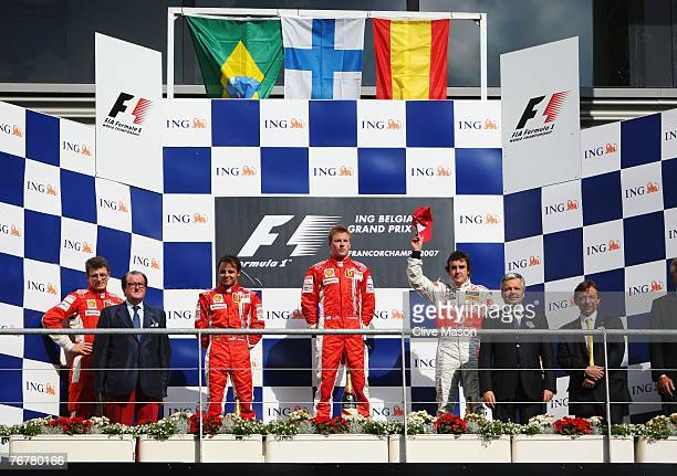 SPA FRANCORCHAMPS BELGIUM SEPTEMBER 16 Second placed Felipe Massa of Brazil and Ferrari race winner Kimi Raikkonen of Finland and Ferrari and third...