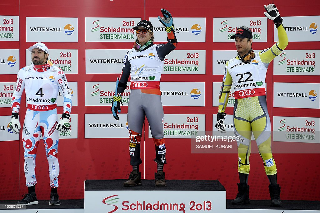 Second placed France's Gauthier De Tessieres, winner US Ted Ligety and Norway's Aksel Lund Svindal pose on the podium after the men's Super-G event of the 2013 Ski World Championships in Schladming, Austria on February 6, 2013.