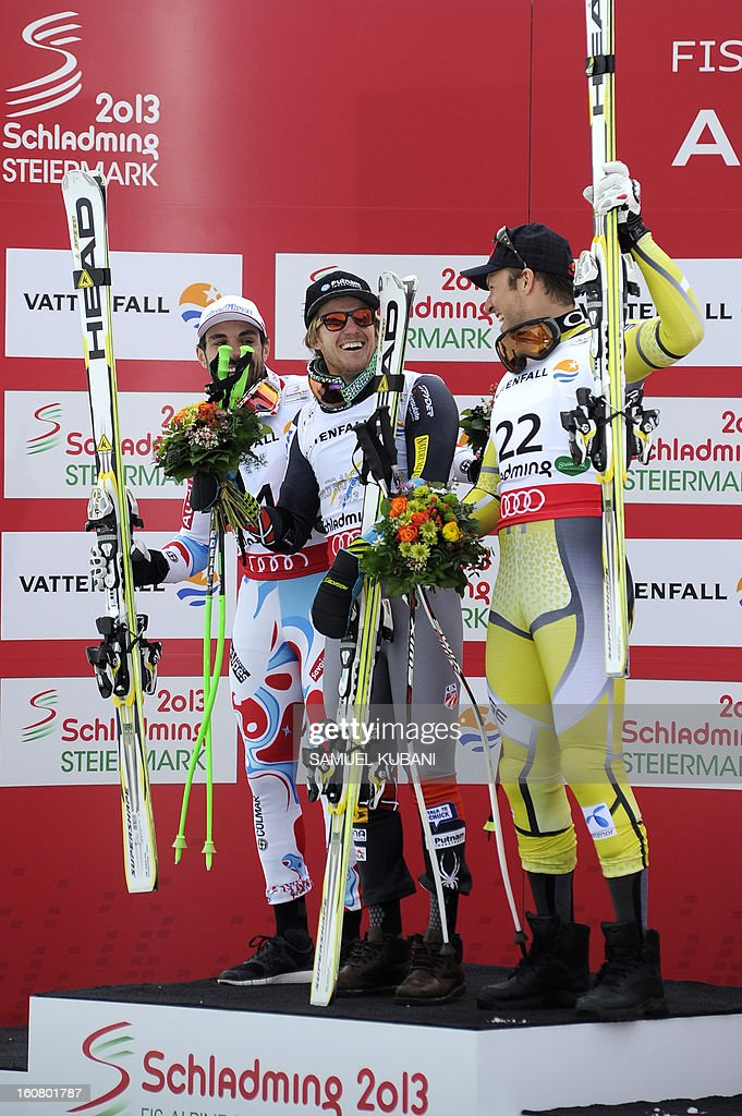 Second placed France's Gauthier De Tessieres (L), Winner US Ted Ligety (C), and third placed Norway's Alsel Lund Svindal celebrate on the podium after the men's Super-G event of the 2013 Ski World Championships in Schladming, Austria on February 6, 2013.